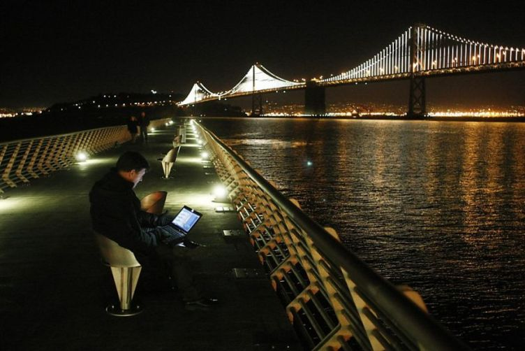 Leo Villareal sequences 25,000 lights spanning the Bay Bridge's suspender cables.
